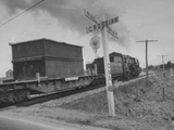 "Modest Criss Cross Sign Reading ""Railroad Crossing"" Train on Track Premium Photographic Print"