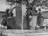 Indian Women and Children Gathered to Get Water from Village Well at Half-Capacity Due to Drought Premium Photographic Print