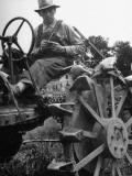 Farmer Sitting on Plow Premium Photographic Print