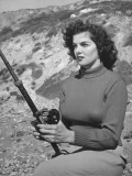 Actress Jane Russell Wearing Khaki Pants and Turtleneck Sweater as She Fishes from Rocks Premium Photographic Print