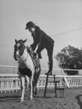 Actress Buff Cobb, Getting Off of Her Horse Premium Photographic Print