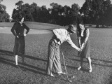 A Woman Watching as a Pro Golf Player Corrects the Stance of a Young Girl Premium Photographic Print