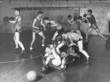 Boys Playing Basketball with Boxing Gloves on at Ucla Premium Photographic Print