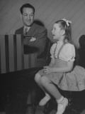 Actress Margaret O'Brien Singing Along with a Man Who Is Playing the Piano Premium Photographic Print