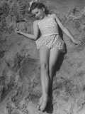 Child Actress Margaret O'Brien Lying on the Sand at the Beach Premium Photographic Print