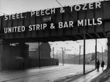 People Walking under Large Sign at Peech and Tozer Steel Plant Premium Photographic Print