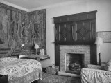 Cranborne Manor Bedroom, with an Old-Fashioned Coverlet, a Fireplace, and Tapestry Hanging Premium Photographic Print