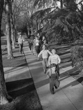 Actor Clifford B. Severn and Family Running Along Sidewalk Premium Photographic Print