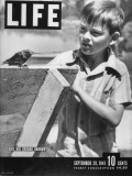 Child Prodigy Gerard Darrow, Playing Outside with His Pet Bird Premium Photographic Print