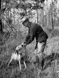 Hunter Taking Quail from Dog's Mouth Premium Photographic Print