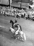 Texan Glenn McCarhty Riding a Horse During a Parade Premium Photographic Print