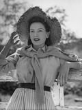 Actress Deborah Kerr Wearing a Straw Hat, a Sweater Tied around Her Shoulders Premium Photographic Print