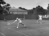 Tennis Players Yvon Petra and Pierre Pellizza in Action Premium Photographic Print