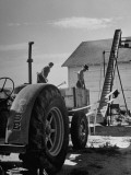 Farmers Storing their Grain Premium Photographic Print