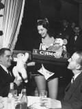 A Cigarette Girl Handing a Patron a Stuffed Animal at the Opening of the Diamond Horseshoe Premium Photographic Print