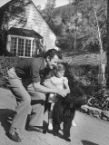 Actor Cornel Wilde Giving His Daughter a Ride on the Family Dog Premium Photographic Print