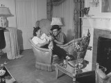 Lou Costello and a Woman Relaxing in a Living Room, Petting a Small Dog Premium Photographic Print