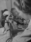 Artist at Madame Tussaud's Waxworks Inserting Hair in Sculpture of Gen Douglas A. Macarthur Premium Photographic Print