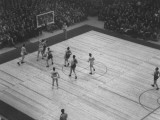 Long Island University's Basketball Team Playing Against Wisconsin University Premium Photographic Print
