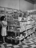Interior View of Modern Grocery Store, Displaying Canned Goods, Cereals and Soap Premium Photographic Print