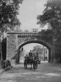 Man Driving Horse and Buggy Through Gate Premium Photographic Print
