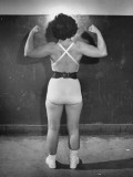 Wrestler Mildred Burke Showing Her Arm and Neck Muscles Premium Photographic Print