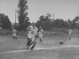 Japanese School Students Playing Soccer Premium Photographic Print