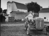 A Ford Tractor Being Sold During the Farmhouse Auction Premium Photographic Print