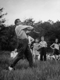 Chester Bowles Playing Baseball at a Picnic Premium Photographic Print