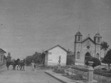 A Man Pulling His Horses Toward the Church Premium Photographic Print