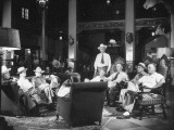 Cattle Men and Natives of San Angelo Sitting in the Lobby of the Cactus Hotel Photographic Print