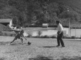 President of Rexall Drugstore Playing Ball with His Wife Premium Photographic Print