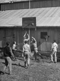 Young Men Playing Basketball with a Homemade Basket in a Farmyard Premium Photographic Print