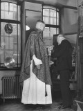 """The Tailor Is Fixing the """"Maniple"""" Worn on the Left Sleeve of the White Alb Premium Photographic Print"""