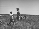 Men Rounding Up Wild Horses on Core Island Premium Photographic Print