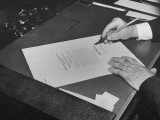 Hands of President Franklin Roosevelt Signing Declaration of War Following Bombing of Pearl Harbor Premium Photographic Print