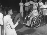 Caodaist Pope Pham Cong Tac Starting Home in the Papal Tricycle after Holding Midnight Mass Premium Photographic Print