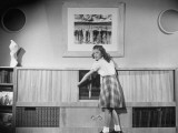 Young Girl Demonstrating Opening of Doors of the Select-O-Matic Phonograph Premium Photographic Print