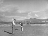 A View of People Playing a Game of Golf Premium Photographic Print