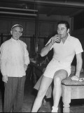 Errol Flynn Taking a Drink on Day of Tennis Match with Bill Tilden Premium Photographic Print