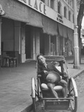 Vietnamese Cyclo-Rickshaw Boy Sleeping in Front of Hotel, Waiting on Fare, in French Indochina Premium Photographic Print