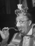 Comedian Ed Wynn Clowning Using a Cheese Fork to Prevent Suffocating from Odor of Limburger Premium Photographic Print