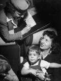 Stewardess Filling Out a Certificate Premium Photographic Print