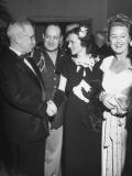 Pres. Harry S. Truman Greeting Grace Moore and Mrs. Dorothy Vredenburgh at Democratic Party Dinner Premium Photographic Print