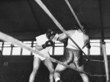 Boxer Joe Louis Fighting in Boxing Match Premium Photographic Print