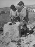 Two Farm Boys Drawing Water from a Well Premium Photographic Print