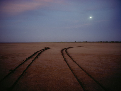 Tire Tracks Reveal Drivers Backing Away from a Flooding Tidal Flat Photographic Print