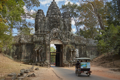 Tuk Tuk Going Through Victory Gate, Angkor Thom, Angkor World Heritage Site, Siem Reap, Cambodia Photographic Print by David Wall