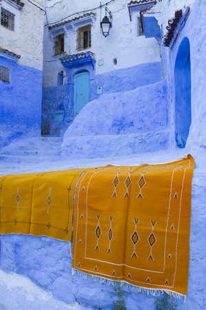 Africa, Morocco, Chefchaouen. Rugs Draped on a Wall in the Blue Town Photographic Print by Brenda Tharp