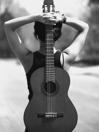 Young Woman Holding an Acoustic Guitar Behind Her Back Photographic Print by Anne W. Krause